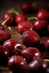 High angle view of wet cherries on wooden table