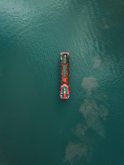 Aerial view of red boat on sea at Bali
