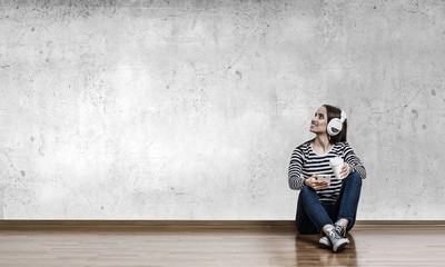 Girl enjoy the music . Mixed media