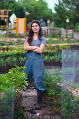 Portrait of confident woman with arms crossed standing at farm