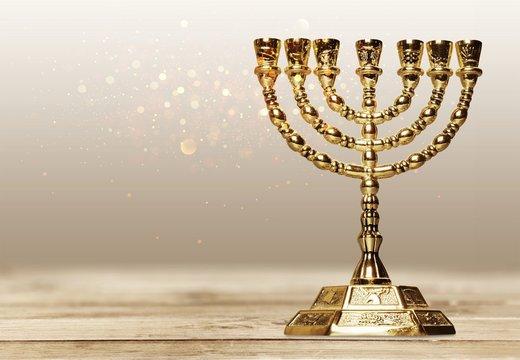 Golden religious menorah isolated on white
