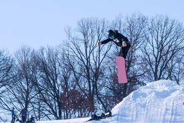 People are enjoying half-pipe skiing/ snowboarding