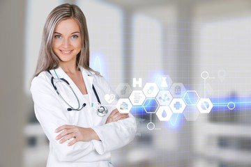Female doctor with stethoscope in a white coat isolated on white