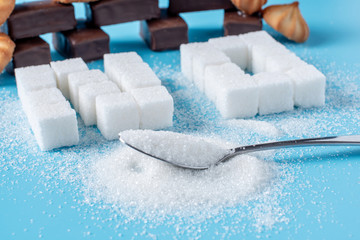 Text No is lined with sugar cubes and sweets. Harm to the health of sweet and rejection of sucrose