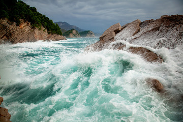 Wall Mural - Beautiful amazing stunning seascape, waves crashing on rocks during a storm, Petrovac Montenegro