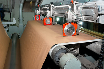 Paper production producing packaging paper and cardboard from waste paper. Pneumatic knives for cutting roll materials. Industrial equipment, paper machine