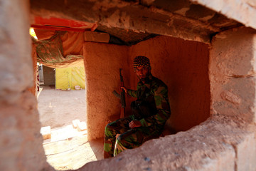 A PMF fighter takes his position at the Iraqi-Syrian border in al-Qaim, Iraq.
