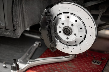 Disk of a luxury sports car at the car service
