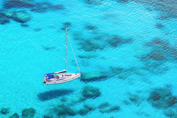 Beautiful bay with sail boat yacht. Yachting, sailing, travel and active lifestyle concept. Enjoying life and summer fun