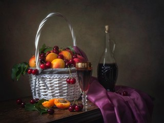 Still life with fruits and red wine