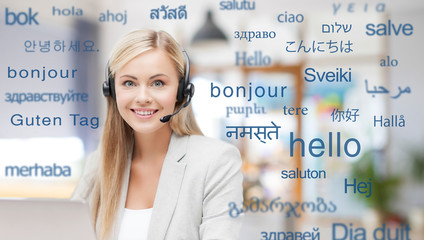 translation, business and technology concept - smiling female translator or operator in headset at...