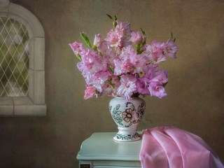 Still life with beautiful bouquet of pink gladiolus