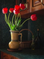 Still life with beautiful bouquet of red tulips