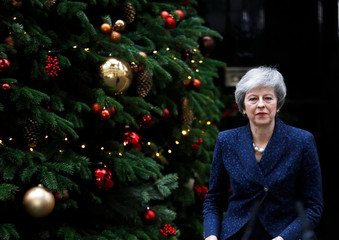 Britain's Prime Minister Theresa May walks out of 10 Downing Street to address the media after it was announced that the Conservative Party will hold a vote of no confidence in her leadership, in London