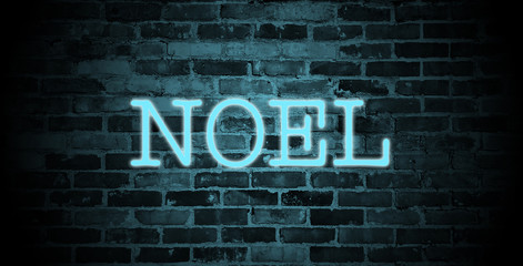 first name Noel in blue neon on brick wall