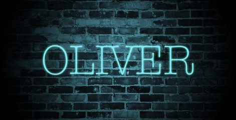first name Oliver in blue neon on brick wall