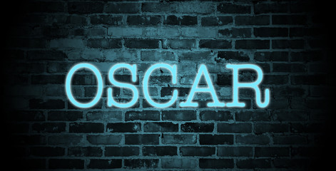 first name Oscar in blue neon on brick wall