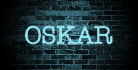 first name Oskar in blue neon on brick wall