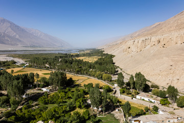 Fertile Wakhan Valley near Vrang in Tajikistan. The mountains in the background are the Hindu Kush in Afghanistan