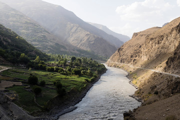 Border river Panj River in Wakhan valley with Tajikistan right and Afghanistan left