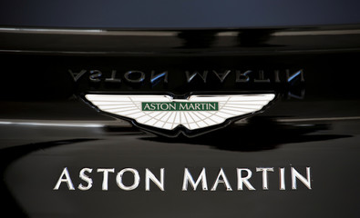 Aston Martin brand logo is seen on a luxury sports car at a dealership in Beijing