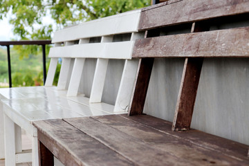 White and brown benches decorated in cafes.