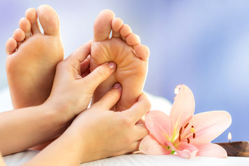 Close up reflexology massage on feet.