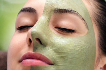 Facial beauty seaweed treatment on young woman.
