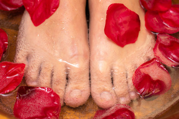 Foot massage with rose petals.
