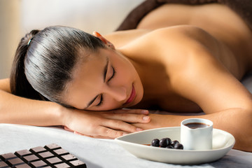 Woman about to have chocolate massage in spa.