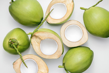 Fresh young coconuts on a white background, creative flat lay healthy food concept