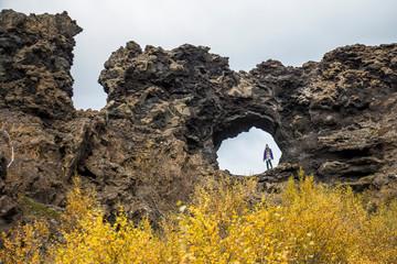 Dimmuborgir lava arch hole on hiking trail, Iceland