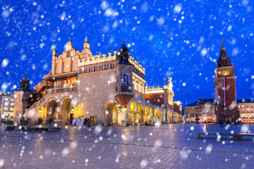 Old town of Krakow on a cold winter night with falling snow, Poland