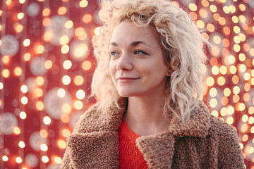 Portrait of a pretty woman with new year decorations and lights