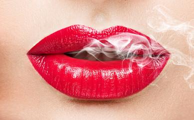 Sexy woman smoking closeup.