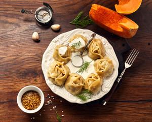 Asian steamed dumplings Manti with pumpkin and garlic.