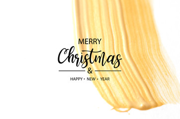 Merry Christmas and Happy New Year. Gold color paint brush stroke.