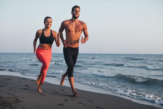 Man and Woman Running on Sandy beach