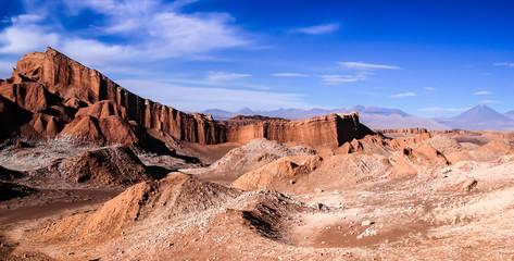 Iconic rock formation in valle de la luna near San Pedro de Atacama feat. vulcano Licancabur in the background