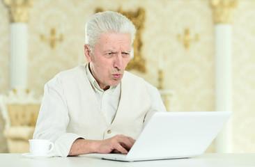 Close up portrait of thoughtful senior man