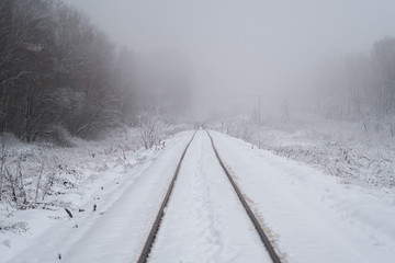 winter landscape. the railway going into the fog