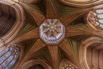 Magnificant stained glass and paintings under the cupola of Ely Cathedral in Cambridgeshire, England.
