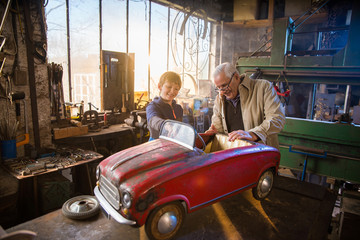 A grandfather and his grandson in the DIY workshop