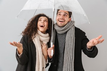 Happy couple wearing autumn clothes standing