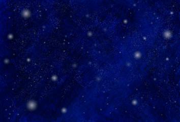 雪が舞う美しい青い夜空の背景素材
