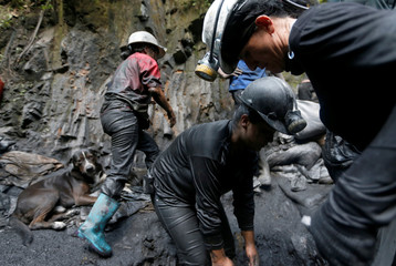 Informal miners wash stone waste in search of emeralds on the outskirts of a mine in the company Fura in Coscuez