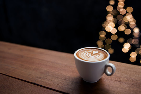 Tasty cappuccino with some blurred lights from Christmas tree.