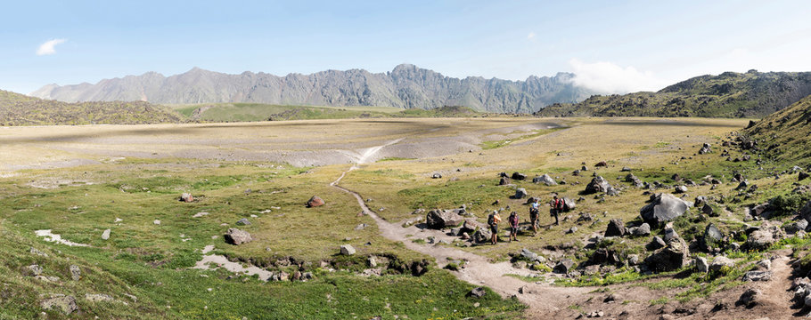 Russia, Caucasus, Mountaineers hiking in Upper Baksan Valley