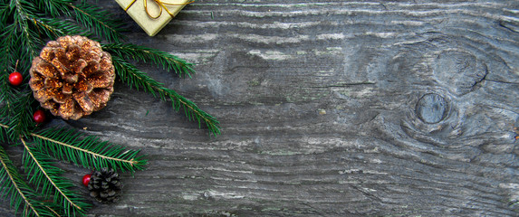 Christmas gift boxes on a rustic wooden background