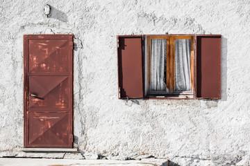 Old Window and Door in brick wall